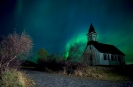 Church bathed in Northern lights